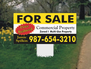 small real estate property signs